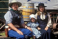 Portrait of frontier family during cowboy reenactment, CA