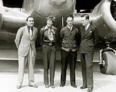 Amelia Earhart Standing With Paul Maas, Harry Manning and Fred Noonan in Front of her Lockheed Electra Airplane, Honolulu Airport, Hawaii, March 20, 1...