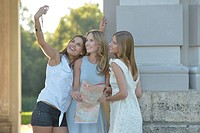 three young women take a picture together