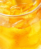 glass of orange juice with ice _ macro