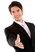 Business man extending his hand offering to close a deal over a white background