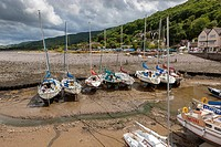 Small boats in Porlock Weir Harbour at low tide, Exmoor National Park, North Devon, England, UK, Europe