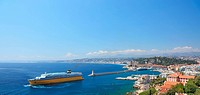 Summer view of the city of Nice and the harbor with crusie ship.