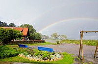 rain and rainbow in the sea resort