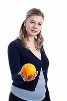 Young woman holding orange fruit, isolated on white background