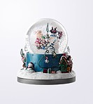 Childs toy Christmas snow globe on white background