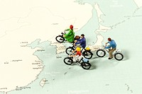 Group of people riding bicycles on map