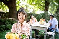 Girl has plate in garden,portrait