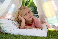 Portrait of boy in tent