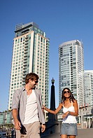 happy couple walking in city