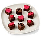 Heart decorated chocolates on a plate