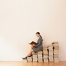 business woman read a book on stack of books