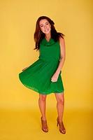 Woman In Green Dress Twirling Her Skirt