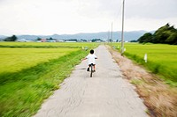 a boy riding on a bicycle