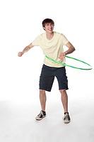 Smiling Caucasian man twirling plastic hoop