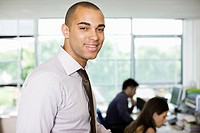 Smiling man in office environment