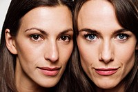 Close up of two brunette women