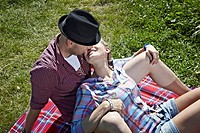 Germany, Cologne, Couple laying in grass