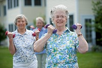 Senior women exercising outdoors