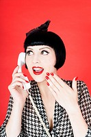 Close up of young woman talking on telephone