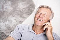 Spain, Senior man talking on mobile, smiling