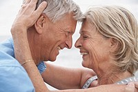 Spain, Senior couple looking at each other, smiling