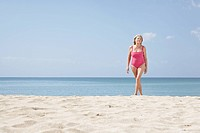 Spain, Mallorca, Senior woman walking on beach