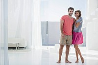Spain, Mid adult couple in modern apartment