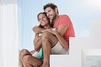 Spain, Mid adult couple sitting on stairway, smiling