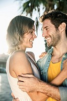 Spain, Mid adult couple looking at each other, smiling (thumbnail)
