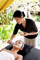 Woman receiving facial at Rebab Spa, Kayumanis Gan