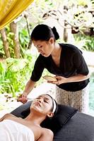 Woman receiving facial at Rebab Spa, Kayumanis Gan