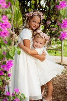 white dressed little sisters