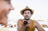 Spain, Mid adult man blowing kiss to woman
