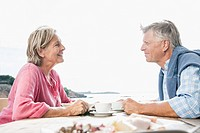 Spain, Senior couple having lunch, smiling (thumbnail)
