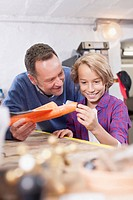 Germany, Leipzig, Father and son repairing toy plane