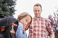 Germany, Leipzig, Father angry with son while going school
