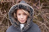 Germany, Leipzig, Boy with fur coat, portrait