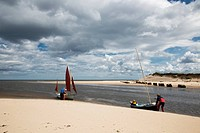 Preparing sailboats at the water´s edge, alnmouth northumberland england