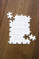 Jigsaw puzzle on wooden floor