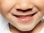 A boy´s nose,mouth,teeth,smiling
