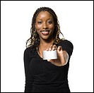 Woman holding bank card smiling