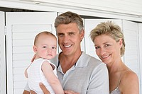 Mature couple with baby boy 12_13 m, Portrait