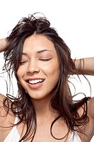 Woman smiling with hands in hair