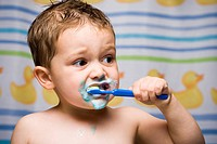 Boy brushing teeth in bathroom