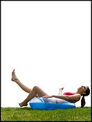 Woman in bikini lying in swimming ring laughing