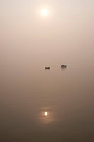 Fishing boat and river ferry on the River Ganges in the early morning, Sonepur, Bihar, India, Asia