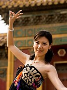 Woman doing tai chi outdoors smiling