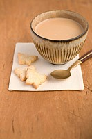 Ginger cookie shaped of butterfly with cup of chai