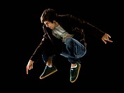young man jumping in the air.